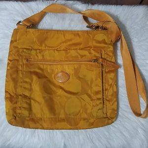 Coach Signature Getaway orange nylon crossbody bag